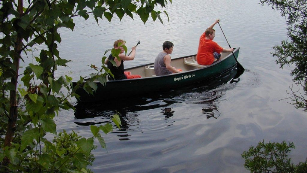 3 boys in canoe